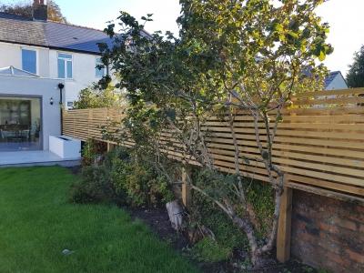 Slatted wooden fence